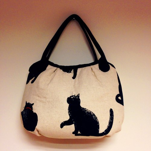 Elegant black cat walking handbag