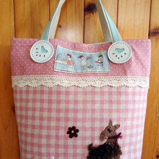 Schnauzer gnawing on a bone / Plaid pink handbag