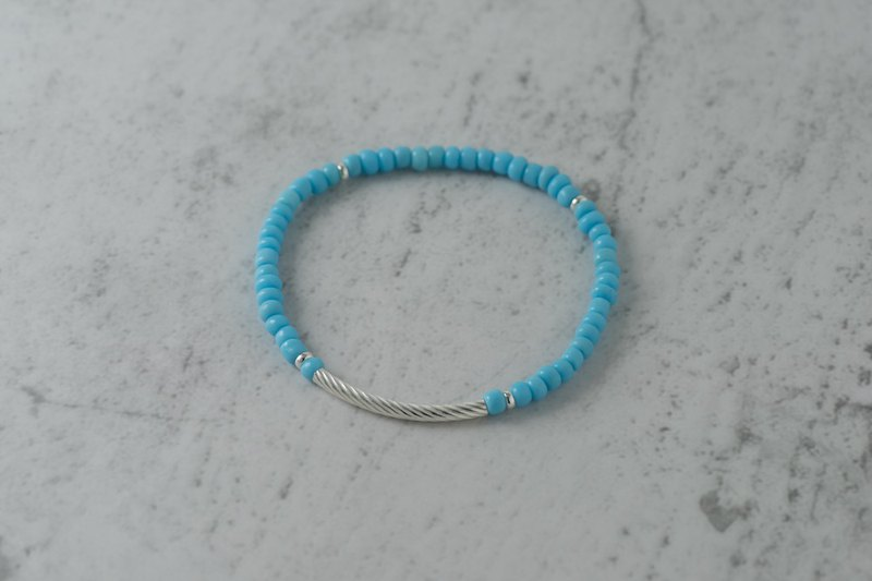 sky. Pink and blue glass bracelets. c section. Spiral silver tube