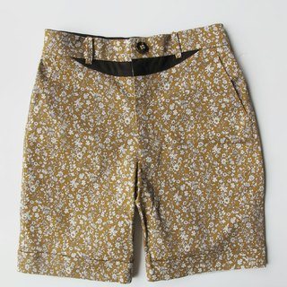 Machismo- smile lines spliced ​​small floral shorts