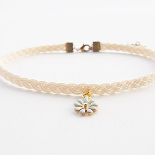 Cream braided choker / necklace with light blue flower charm.