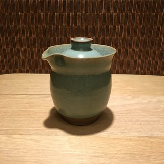 **Simple hand-made porcelain pot**