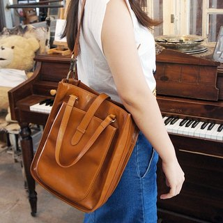 catXbow-knot} portable hand-stitched leather shoulder bag _ _ _ Taiwan Design Limited Caramel Hand _