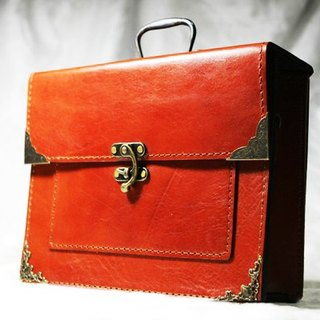 35. The hand-stitched leather vintage handbag / briefcase