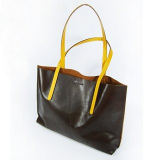 Dark brown leather tote with yellow strap