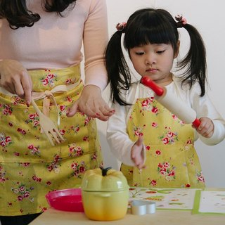 Child flowers yellow apron