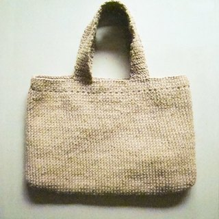 The old lady is going to buy a linen rope handmade bag