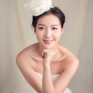 Silk millinery bridal hat with feathers
