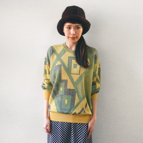 Yellow and green a few close knit sweater