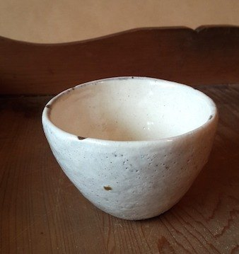 Handmade pottery clay cup white powder primer