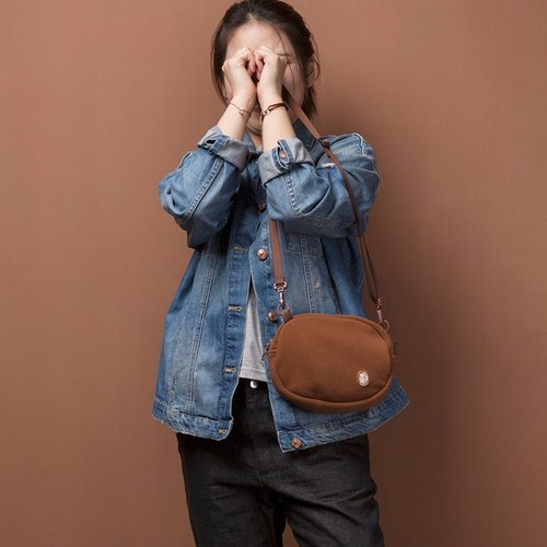 ntmy. oval caramel color small shoulder bag backpack oblique backpack