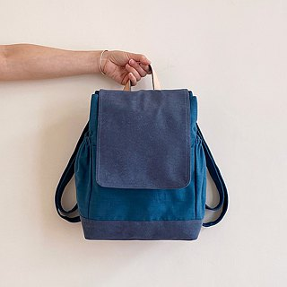 Handmade blue cotton cloth decorated with a leather backpack
