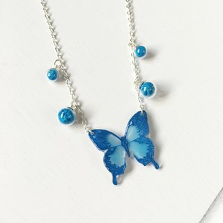 Luminous blue swallowtail hand painted butterfly bright glass necklace