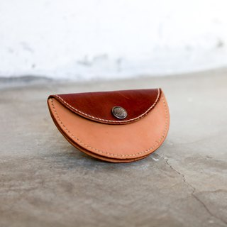 26. The hand-stitched leather round purse