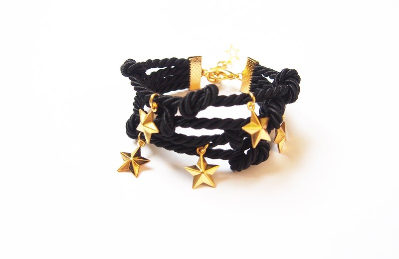 Black handmade bracelet with gold star charm
