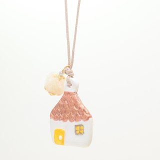 a little white house handmade necklace from Niyome clay.