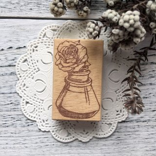 Hand- drawn stamp Rose blossom magic bottle