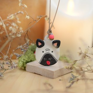 a little pug dog handmade necklace from Niyome clay.