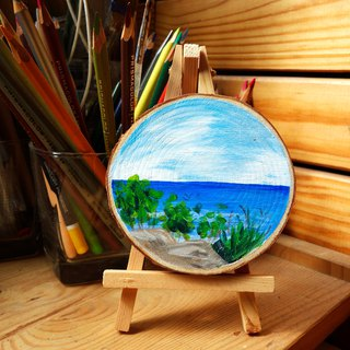 """The popular rocks from Ocean Home"" Minimized painting on wood slice."