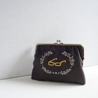Embroidered gold bag - glasses