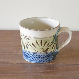 Green glazed Tang Dynasty mug