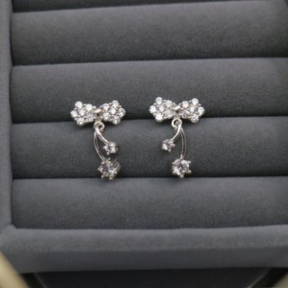 Small ornate bow earrings