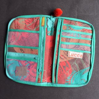Multi-purpose hand-printed silk purse in hand