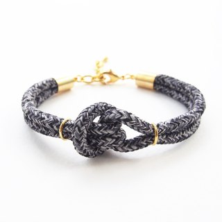 Black knot bracelet with gold material