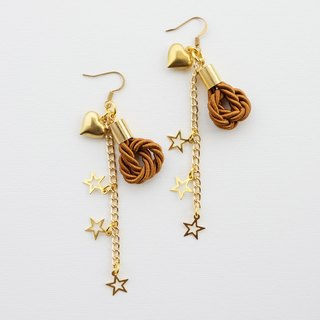 Brown knotted rope and gold long-chain earrings with stars and heart