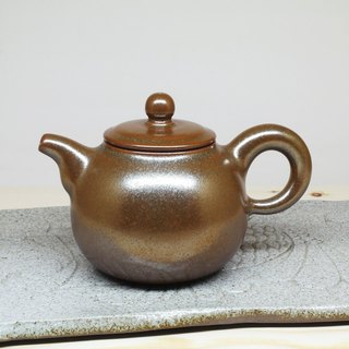 Possession of gold enamel teapot round being hand-made pottery tea props