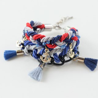 Blue red gray braided bracelet with anchors and tassels