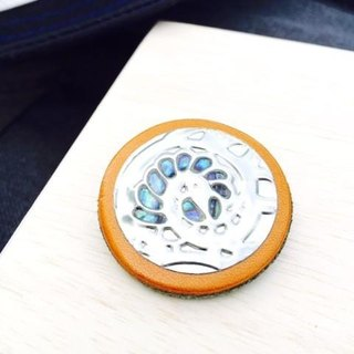 Leather brooch is two-tone in color(shell)
