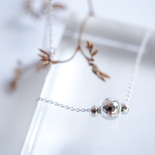 Triple floating silver bead necklace