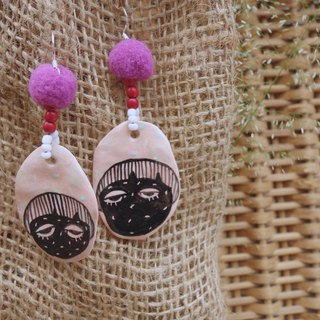 Ceramic earring inspired by woman face in pink :)