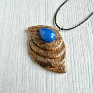 Wooden carved pendant with chalcedony