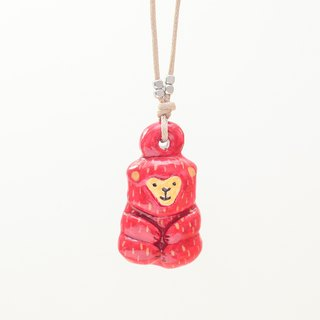 a little red lucky monkey handmade necklace from Niyome clay.