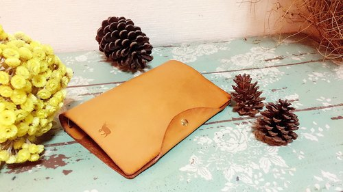 Brown tanned leather handbook