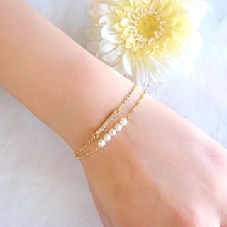 Two pairs of pearl and crystal bracelet