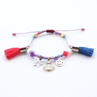 Small star / anchor / smiley charm string bracelet with red and blue tassel