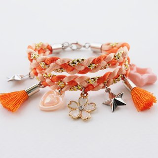 Orange double-layer braided bracelet with charms