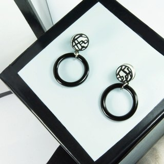 Circular geometric squares misplaced earrings