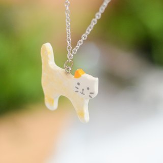 a little Yellow cat handmade necklace from Niyome Clay.
