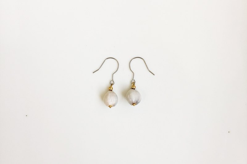 From South Nanfei Seed Styling Earrings