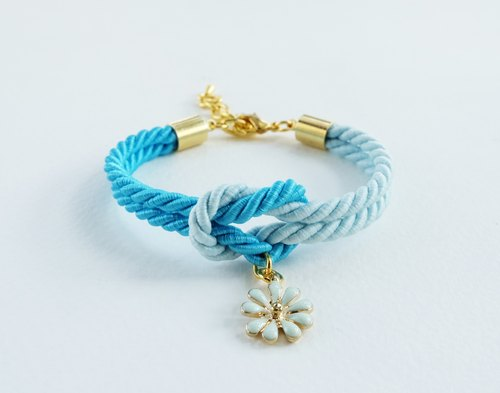 Blue tie the knot bracelet with flower charm