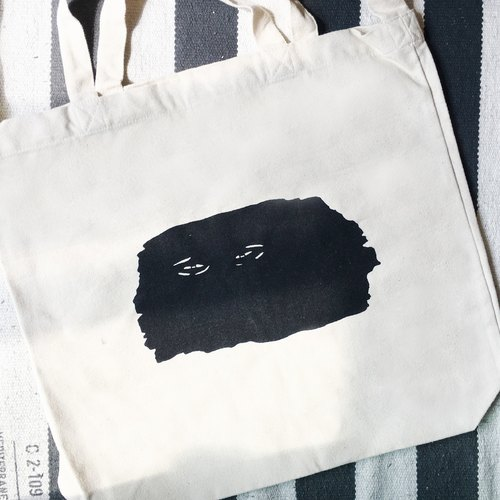 Weary face canvas bag / shoulder can be put