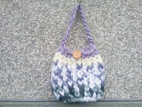 Hand-knitted of colorful handmade coarse lines of warm healing handbag