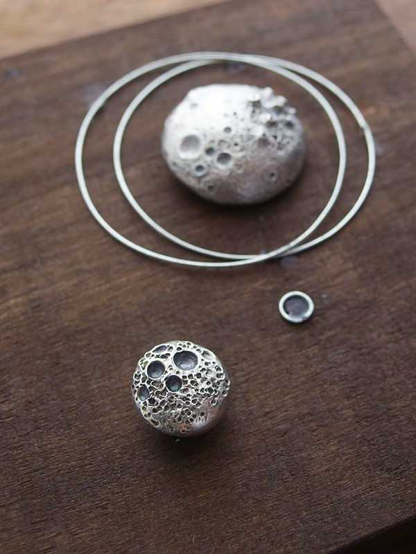 Silver necklace crater small planet / universe planets