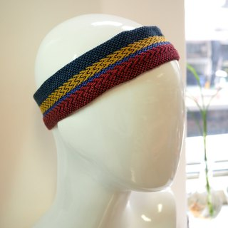 Woven and shaved head with red, yellow and blue