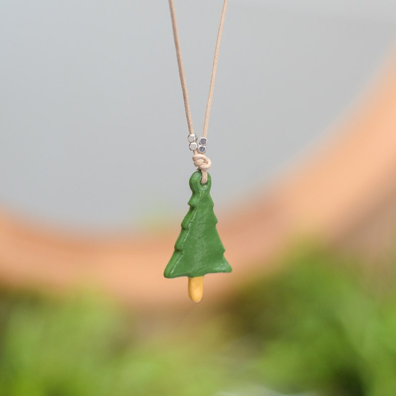 A little green pine tree handmade necklace from Niyome Clay.