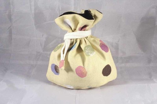 There are mini tote bag bottom - little yellow color